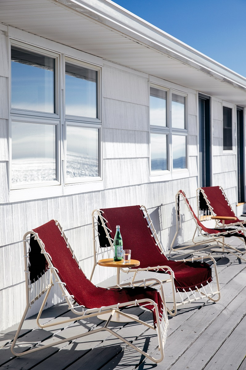 Lounge chairs on waterfront deck