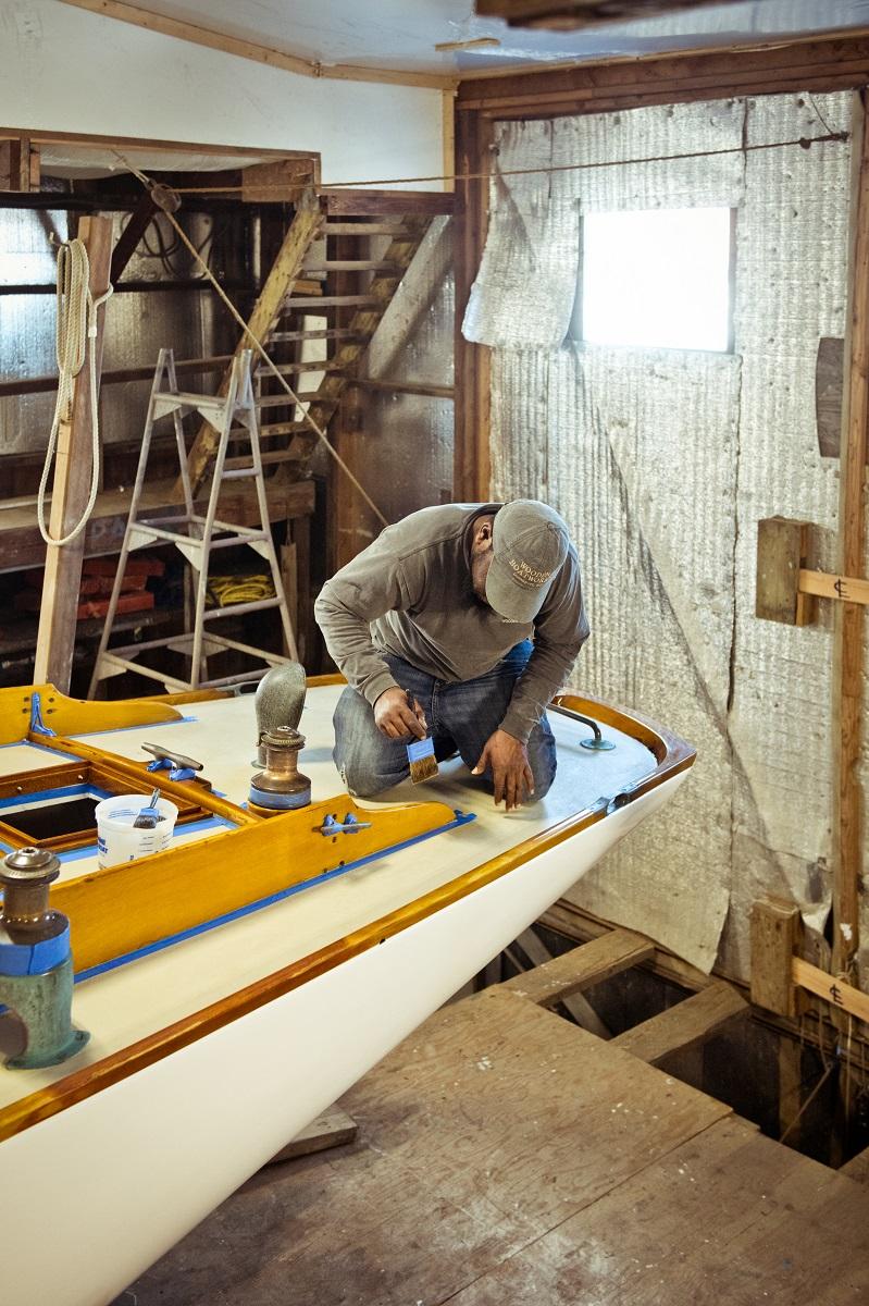 Man repairing a boat