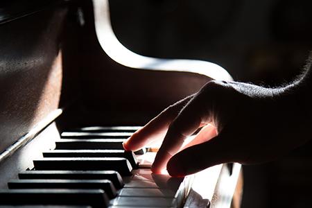 Man playing piano bar