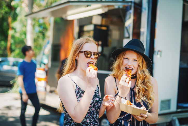 Two Girls Eating Food Truck Food