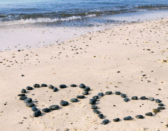 Rock hearts on beach