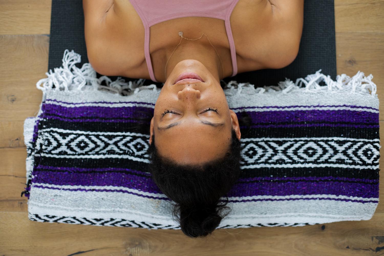 Woman laying down meditating