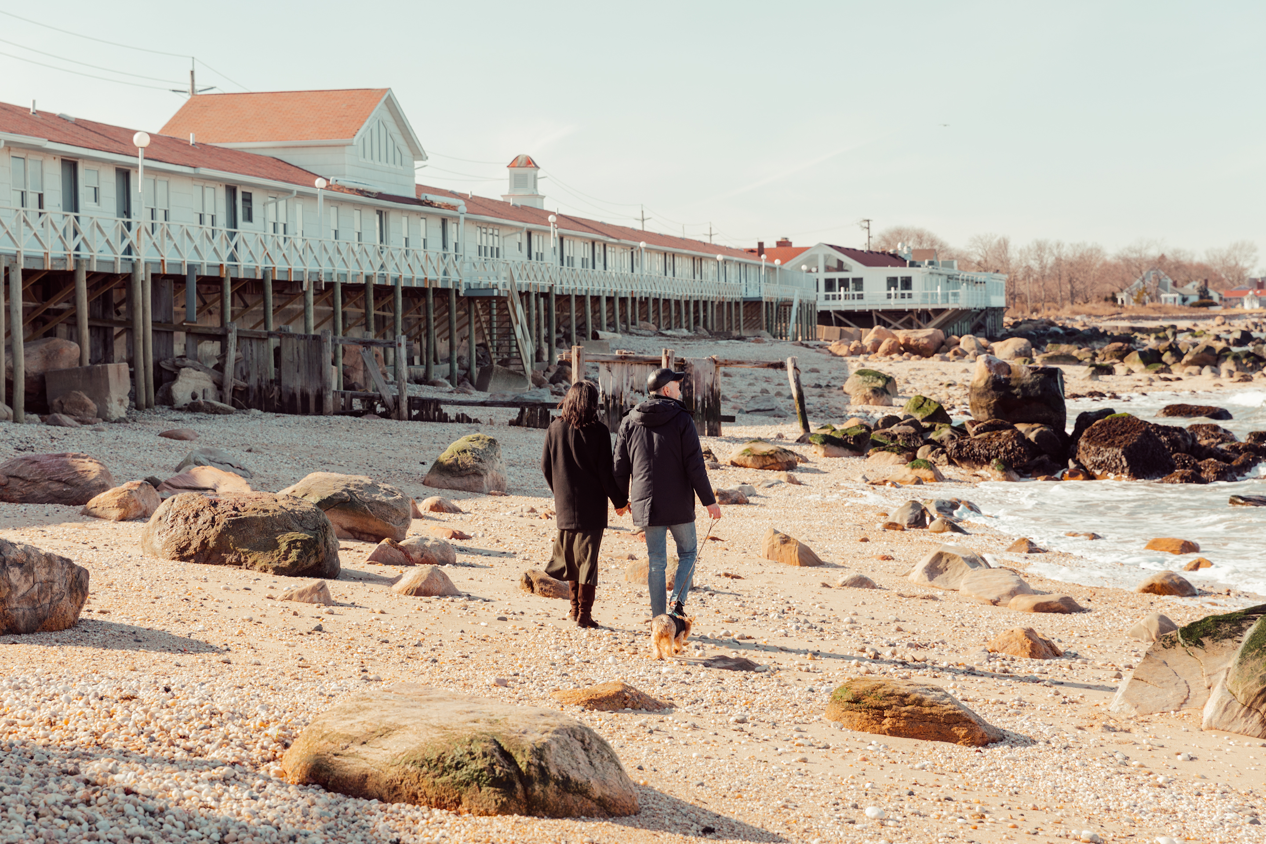 Winter couple walking on beach