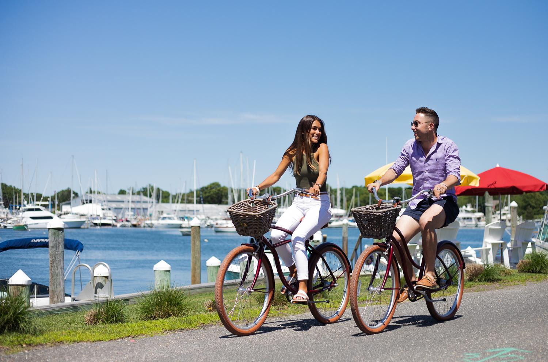 2 guest riding bike near water